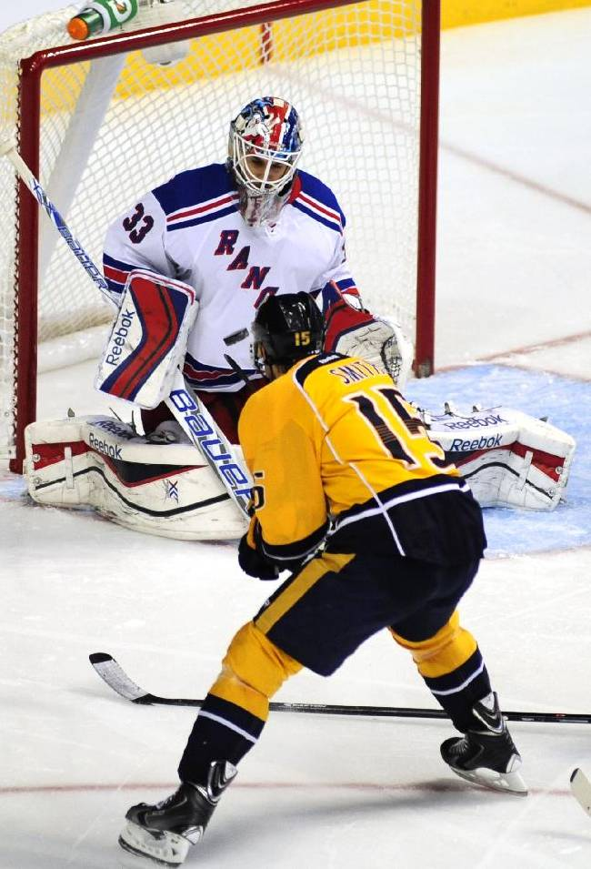 New York Rangers goalie Cam Talbot (33) stops the shot of Nashville Predators forward Craig Smith (15) in the second period of an NHL hockey game on Saturday, Nov. 23, 2013, in Nashville, Tenn