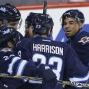 Winnipeg Jets' Evander Kane (9), Grant Clitsome (24), Jay Harrison (23), Matt Halischuk and Adam Lowry (17) celebrate Kane's goal on the Boston Bruins during the first period of an NHL hockey game Friday, Dec. 19, 2014, in Winnipeg, Manitoba. (AP Photo/The Canadian Press, John Woods)