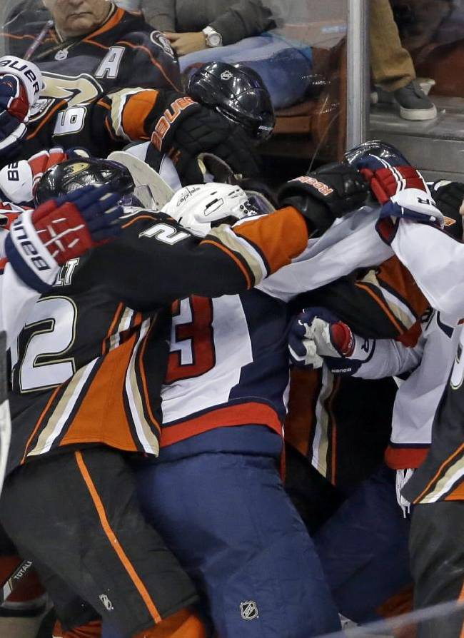 With six seconds left in the game, the Anaheim Ducks and Washington Capitals mix it up in the third period of an NHL hockey game Tuesday, March 18, 2014. The Capitals won, 3-2