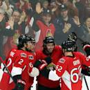 Ottawa Senators' Mika Zibanejad (93)celebrates his goal against the Vancouver Canucks with teammates Jared Cowen (2) Bobby Ryan (6) and Eric Gryba (62) during NHL second period action in Ottawa, Ontario, Sunday, Dec. 7, 2014 The Associated Press