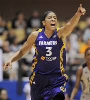 Los Angeles Sparks' Candace Parker celebrates a basket during the first half of a WNBA playoff basketball game against the San Antonio Silver Stars, Saturday, Sept. 29, 2012, in San Antonio. (AP Photo/Darren Abate)