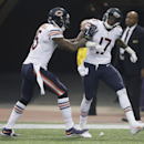 Chicago Bears wide receiver Alshon Jeffery (17) celebrates with teammate Brandon Marshall after catching a 46-yard touchdown pass during the second half of an NFL football game against the Minnesota Vikings, Sunday, Dec. 1, 2013, in Minneapolis The Associ