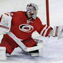 Carolina Hurricanes goalie Cam Ward reaches to block a shot during the third period of an NHL hockey game against the Buffalo Sabres in Raleigh, N.C., Thursday, Jan. 8, 2015. Carolina won 5-2 The Associated Press