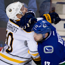 Buffalo Sabres' Christian Ehrhoff, left, of Germany, and Vancouver Canucks' Ryan Kesler collide during third period NHL hockey action in Vancouver, British Columbia, on Sunday March 23, 2014 The Associated Press