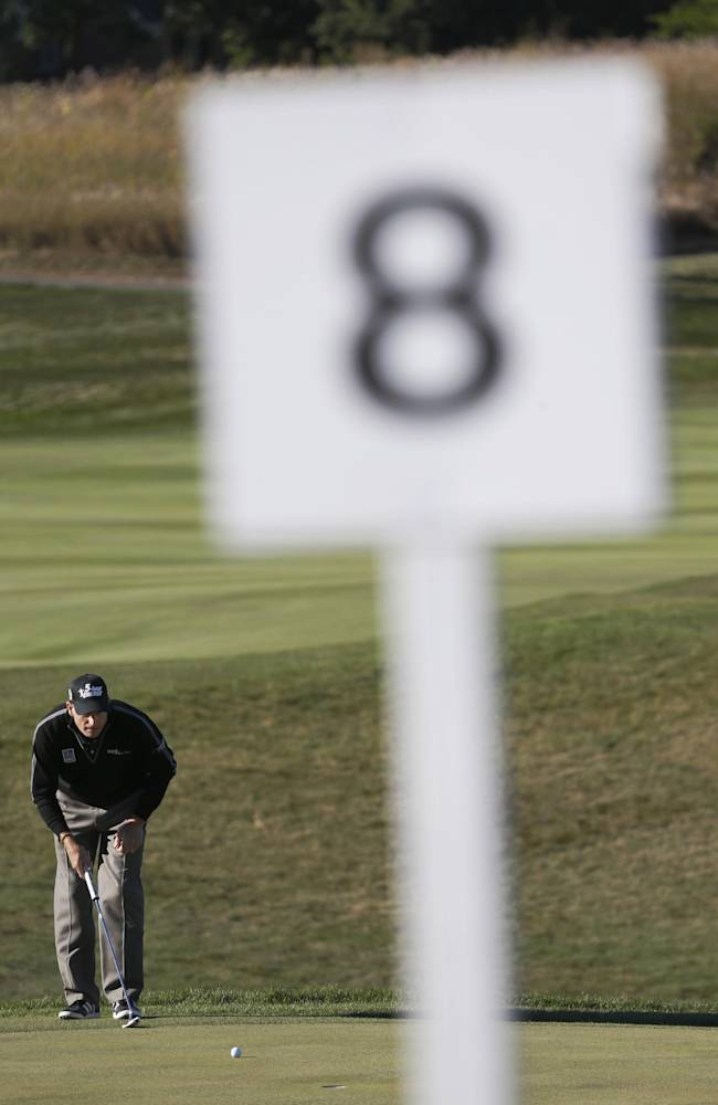 Jim Furyk lines up his par-saving putt on the eighth green during the second round of the BMW Championship golf tournament at Conway Farms Golf Club in Lake Forest, Ill., Friday, Sept. 13, 2013. Furyk posted a 12-under-par 59, tying a PGA record for the lowest score in a round