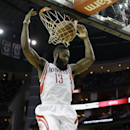 Houston Rockets' James Harden (13) dunks the ball against the Golden State Warriors during the fourth quarter of an NBA basketball game Friday, Dec. 6, 2013, in Houston. The Rockets won 105-83 The Associated Press