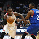 Atlanta Hawks forward Paul Millsap (4) drives past Philadelphia 76ers forward Thaddeus Young (21) in the first half of an NBA basketball game Monday, March 31, 2014, in Atlanta. Atlanta defeated Philadelphia 103-95. Millsap scored a game high 28 points Th
