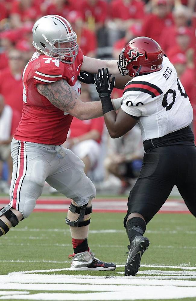In this Sept. 7, 2013, file photo, Ohio State offensive lineman Jack Mewhort blocks against San Diego State during an NCAA college football game in Columbus, Ohio.  No. 4 Ohio State has a dynamic quarterback in Braxton Miller, a powerful force at tailback named Carlos Hyde and several prime weapons as receivers. Yet coach Urban Meyer says it's his line that carries the offense