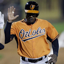 Baltimore Orioles' Adam Jones scores during the sixth inning of a spring exhibition baseball game against the Pittsburgh Pirates in Bradenton, Fla., Thursday, March 20, 2014. The Orioles won 4-2 The Associated Press
