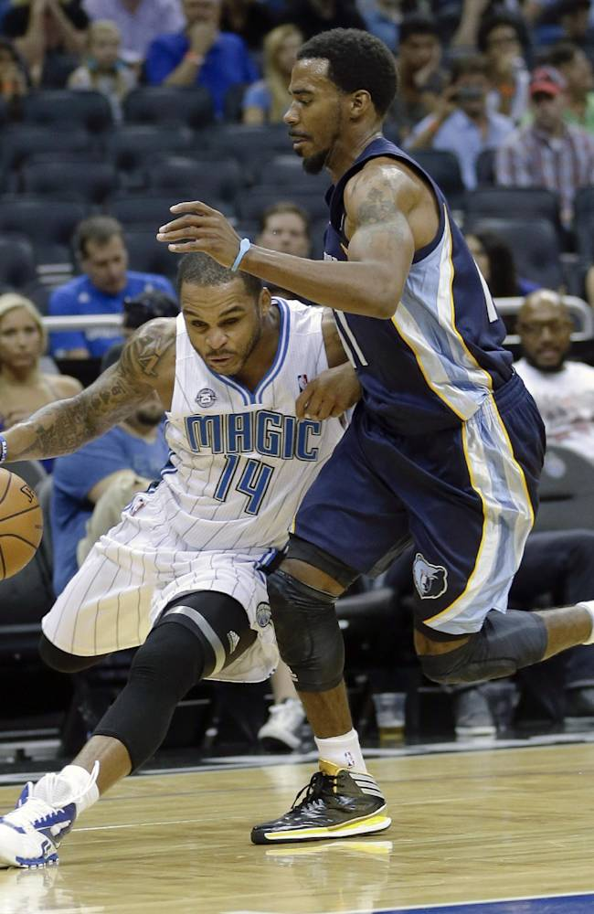 Orlando Magic's Jameer Nelson (14) drives around Memphis Grizzlies' Mike Conley, right, during the second half of an NBA preseason basketball game in Orlando, Fla., Friday, Oct. 18, 2013. The Memphis Grizzlies won the game 97-91