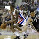San Antonio Spurs guard Danny Green (4) falls as Detroit Pistons guard Kentavious Caldwell-Pope controls the ball during the first half of an NBA basketball game in Auburn Hills, Mich., Monday, Feb. 10, 2014 The Associated Press