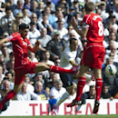 Tottenham Hotspur's Andros Townsend tries to shoot past Liverpool's Steven Gerrard, right, and Emre Can, left, during their English Premier League soccer match at White Hart Lane, London, Sunday, Aug. 31, 2014