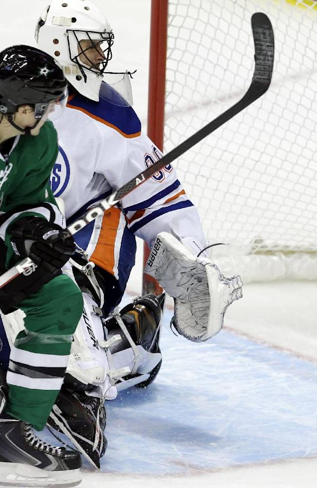 Dallas Stars left wing Ryan Garbutt (16) scores a goal against Edmonton Oilers goalie Ilya Bryzgalov during the second period of an NHL hockey game Sunday, Dec. 1, 2013, in Dallas