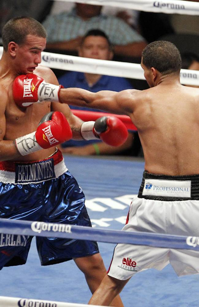 Jerry Belmontes, left, tries to avoid a punch from Abner Cotto, of Puerto Rico, during a boxing match Thursday, Aug. 7, 2014, in Corpus Christi, Texas. Cotto won by a split decision