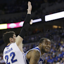 Seton Hall's Eugene Teague (21) is guarded by Creighton's Avery Dingman (22) in the first half of an NCAA college basketball game in Omaha, Neb., Sunday, Feb. 23, 2014. (AP Photo/Nati Harnik)