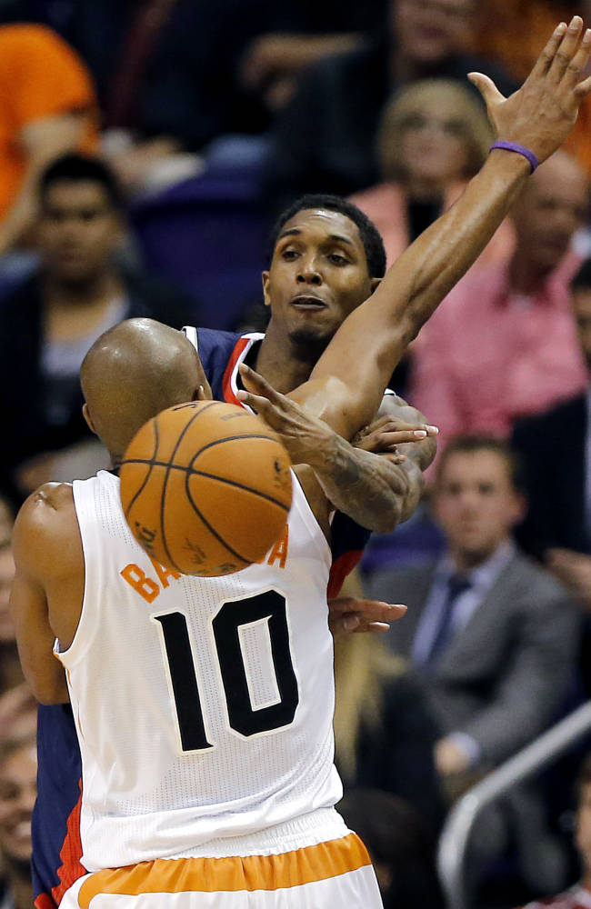 Phoenix Suns' Leandro Barbosa (10), of Brazil, pressures Atlanta Hawks' Louis Williams during the second half of an NBA basketball game, Sunday, March 2, 2014, in Phoenix. The Suns won 129-120