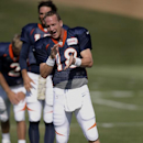 Denver Broncos' Peyton Manning claps for the music choice played during NFL football training camp on Monday, July 28, 2014, in Englewood, Colo The Associated Press