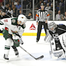 Los Angeles Kings goalie Jonathan Quick, right, stops a puck off Minnesota Wild left wing Zach Parise (11) during the third period of an NHL hockey game in Los Angeles on Sunday, Oct. 19, 2014. The Kings won 2-1 The Associated Press