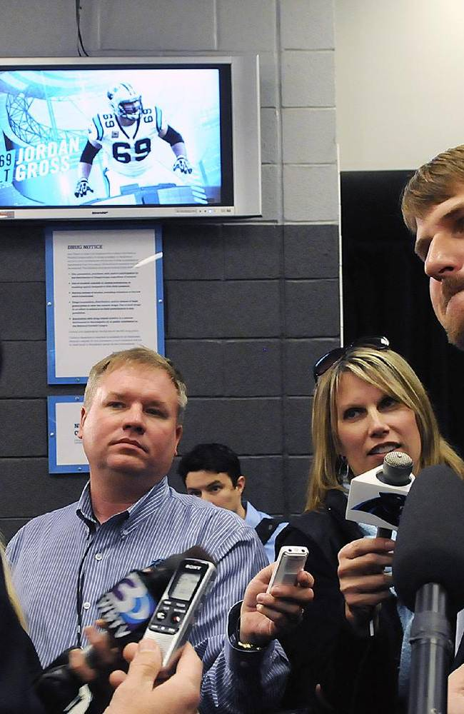 Carolina Panthers offensive tackle Jordan Gross is surrounded by the media after a news conference announcing his retirement after 11 seasons as a pro football player in Charlotte, N.C., Wednesday, Feb. 26, 2014