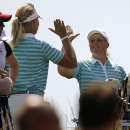 Europe's Anna Nordqvist, left, of Sweden, left, and Caroline Hedwall, of Sweden, celebrate after Nordqvist made a hole in one on the 17th hole to win their foursome match 2 and 1 in the Solheim Cup golf tournament, Saturday, Aug. 17, 2013, in Parker, Colo. (AP Photo/Chris Carlson)
