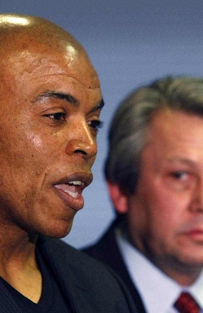 Former Kansas City Chiefs linebacker Chris Martin, left, and his attorney Ken McClain, right, talk about their lawsuit filed today against the Kansas City Chiefs organization during a news conference in Independence, Mo, Tuesday, Dec. 3, 2013.  The lawsuit on behalf of five former Kansas City Chiefs players for  failing to disclose the dangers of competing after suffering head injuries