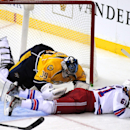 New York Rangers left wing Rick Nash (61) collides with \Nashville Predators goalie Marek Mazanec (39), of the Czech Republic, in the second period of an NHL hockey game on Saturday, Nov. 23, 2013, in Nashville, Tenn The Associated Press