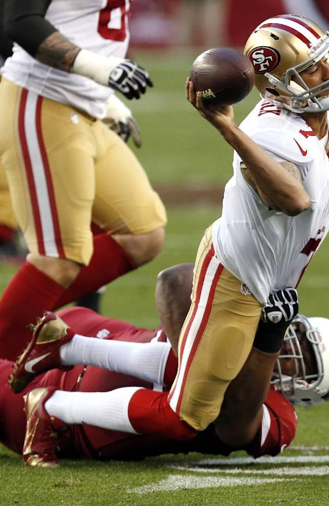 San Francisco 49ers quarterback Colin Kaepernick (7) is pressured by Arizona Cardinals defensive end Calais Campbell during the second half of an NFL football game, Sunday, Dec. 29, 2013, in Glendale, Ariz. The 49ers won 23-20