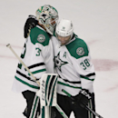 Dallas Stars goalie Kari Lehtonen, left, celebrates with center Vernon Fiddler (38) after beating the Chicago Blackhawks 6-3 in an NHL hockey game, Sunday, Jan. 18, 2015, in Chicago The Associated Press
