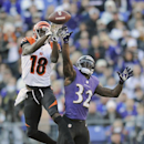 Cincinnati Bengals wide receiver A.J. Green pulls in a pass under pressure from Baltimore Ravens strong safety James Ihedigbo during the second half of a NFL football game in Baltimore, Sunday, Nov. 10, 2013 The Associated Press