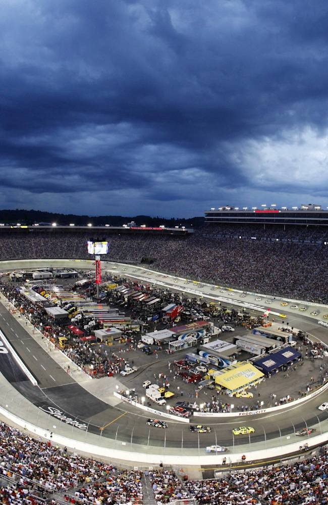 In this Aug. 22, 2009, file photo, the NASCAR Sprint Cup Series Sharpie 500 auto race is run under the lights at Bristol Motor Speedway in Bristol, Tenn.  A person with knowledge of the plans tells The Associated Press on Wednesday, Oct. 9, 2013, that Tennessee and Virginia Tech will play an NCAA college football game at the speedway in September 2016. The person spoke on condition of anonymity because an official announcement is still in the works. The speedway holds 150,000. The attendance record for college football is 115,109, set last month at Michigan Stadium for the Michigan-Notre Dame game