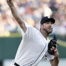 Detroit Tigers starter Justin Verlander pitches against the New York Yankees in the first inning of a baseball game Monday, Aug. 6, 2012, in Detroit. (AP Photo/Duane Burleson)