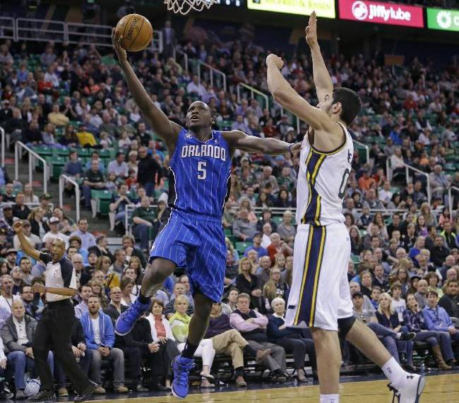 Orlando Magic's Victor Oladipo (5) goes to the basket as Utah Jazz's Enes Kanter (0), of Turkey, defends in the second quarter during an NBA basketball game on Saturday, March 22, 2014, in Salt Lake City