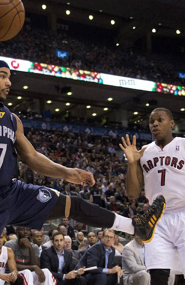 Memphis Grizzlies Jerryd Bayless, left, flies out of bounds as he saves a ball past Toronto Raptors Kyle Lowry during the first half of a preseason NBA basketball game in Toronto on Wednesday, Oct. 23, 2013