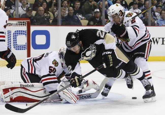 Chicago Blackhawks' Duncan Keith (2) clears Pittsburgh Penguins' Lee Stempniak (22) out of the goal crease in front of Blackhawks goalie Corey Crawford(50) in the second period of an NHL hockey game in Pittsburgh, Sunday, March 30, 2014