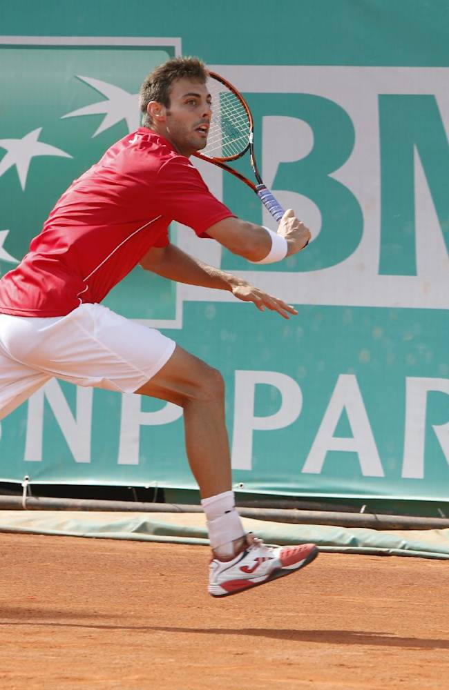 Marcel Granollers of Spain plays a shot against Spain's Guillermo Garcia-Lopez, in the final of the Grand Prix Hassan II tennis tournament in Casablanca, Morocco, Sunday, April 13, 2014.  Guillermo Garcia-Lopez defeated Marcel Granollers 5-7, 6-4. 6-3