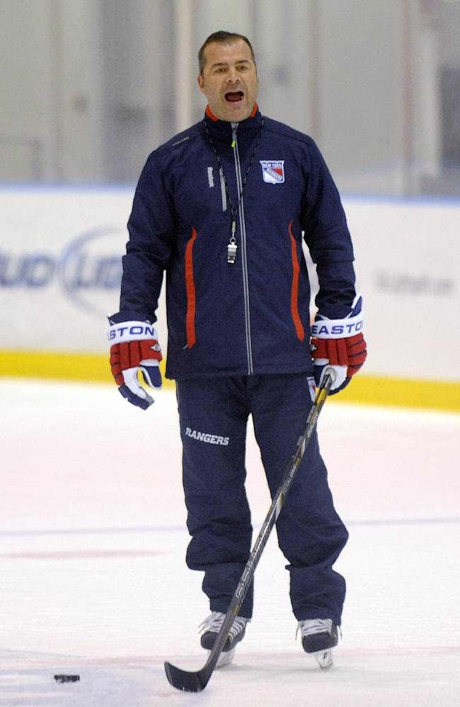 New York Rangers coach Alain Vigneault runs a practice at NHL hockey training camp Friday, Sept. 13, 2013, in Greenburgh N.Y