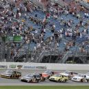 NASCAR trucks start the NASCAR Camping World Truck Series auto race at Chicagoland Speedway in Joliet, Ill., Saturday, July 21, 2012. (AP Photo/Nam Y. Huh)