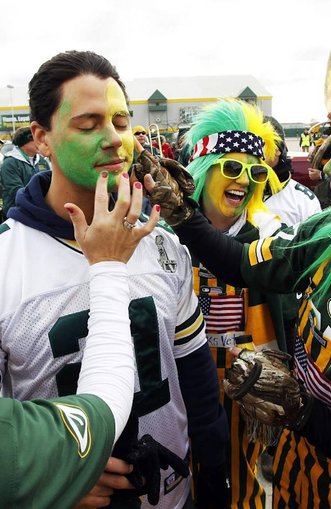 Michael Baes gets some makeup put on his face before an NFL football game between the Green Bay Packers and the Philadelphia Eagles Sunday, Nov. 10, 2013, in Green Bay, Wis