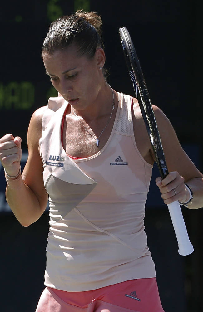 Flavia Pennetta, of Italy, reacts after a point against Shelby Rogers, of the United States, during the second round of the 2014 U.S. Open tennis tournament, Thursday, Aug. 28, 2014, in New York