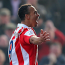 Stoke City's Peter Odemwingie, celebrates his goal, during the English Premier League soccer match against Hull City, at the Britannia Stadium, Stoke On Trent, England, Saturday March 29, 2014
