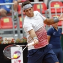 Argentina's Juan Martin Del Potro returns the ball to France's Benoit Paire during their match at the Italian Open tennis tournament in Rome, Thursday, May 16, 2013. (AP Photo/Riccardo De Luca)