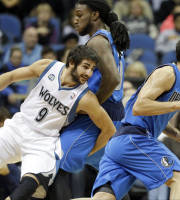 Minnesota Timberwolves' Ricky Rubio, left, of Spain, becomes entangled with with Dallas Mavericks' Jae Crowder as Mavericks' Jose Calderon, right, also of Spain, drives by in the first quarter of an NBA basketball game on Friday, Nov. 8, 2013, in Minneapolis. (AP Photo/Jim Mone)