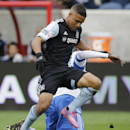 Chicago Fire forward Quincy Amarikwa, front, controls the ball as Montreal Impact defender Hassoun Camara (6) tackles during the first half of an MLS soccer game on Sunday, Oct. 5, 2014, in Bridgeview, Ill The Associated Press