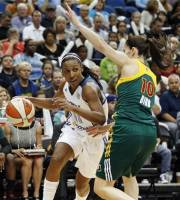 Minnesota Lynx guard Candice Wiggins (11) looks to make a pass against Seattle Storm guard Sue Bird (10) in the first half of Game 3 of their WNBA basketball first-round playoff series, Tuesday, Oct. 2, 2012, in Minneapolis. (AP Photo/Stacy Bengs)