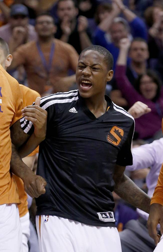 From left to right, Phoenix Suns' Channing Frye, Archie Goodwin, and Dionte Christmas cheer for teammate Ish Smith after he scores against the Indiana Pacers during the second half of an NBA basketball game Wednesday, Jan. 22, 2014, in Phoenix.  The Suns defeated the Pacers 124-100