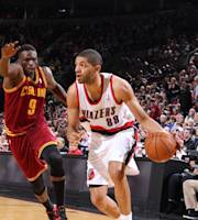 PORTLAND, OR - JANUARY 15: Nicolas Batum #88 of the Portland Trailblazers drives to the basket against the basket against the Cleveland Cavaliers January 15, 2014 at the Moda Center Arena in Portland, Oregon. (Photo by Sam Forencich/NBAE via Getty Images)