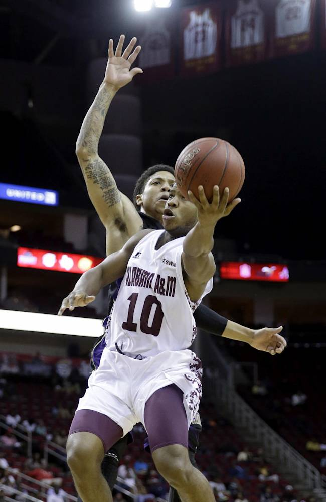 Alabama A&M's Jeremy Crutcher (10) goes up for a shot as Prairie View A&M's Louis Munks defends during the first half of an NCCA college basketball game in the semifinals of the Southwestern Athletic Conference tournament Friday, March 14, 2014, in Houston