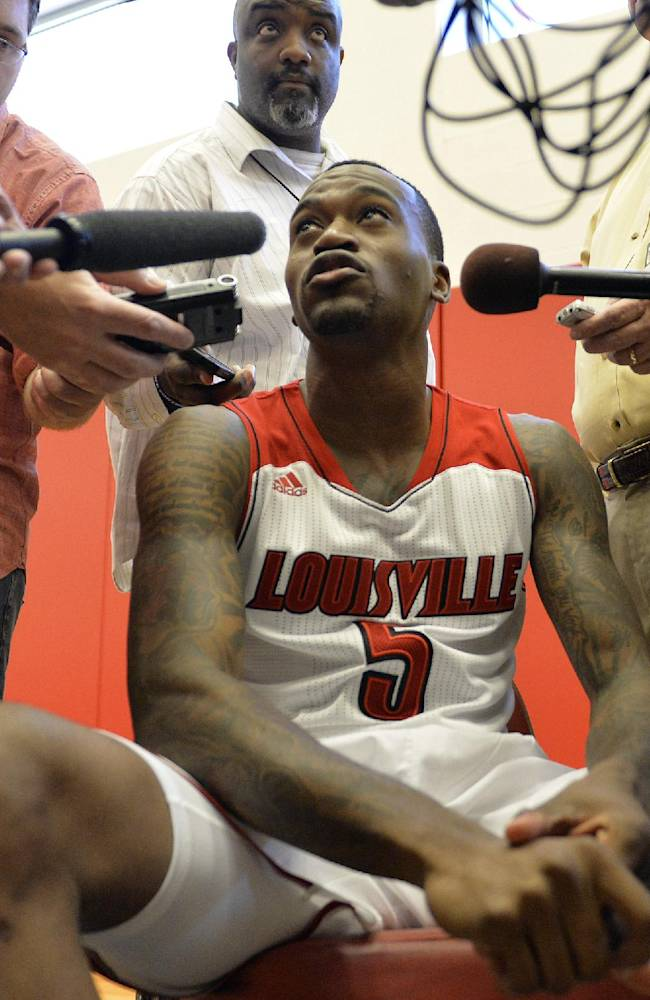 Louisville's Kevin Ware speaks with reporters during NCAA college basketball media day, Saturday, Oct. 12, 2013, in Louisville, Ky