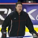 FILE- Inthis May 27, 2006, file photo, Quebec Remparts coach Patrick Roy puts his squad through hockey practice in Moncton, N