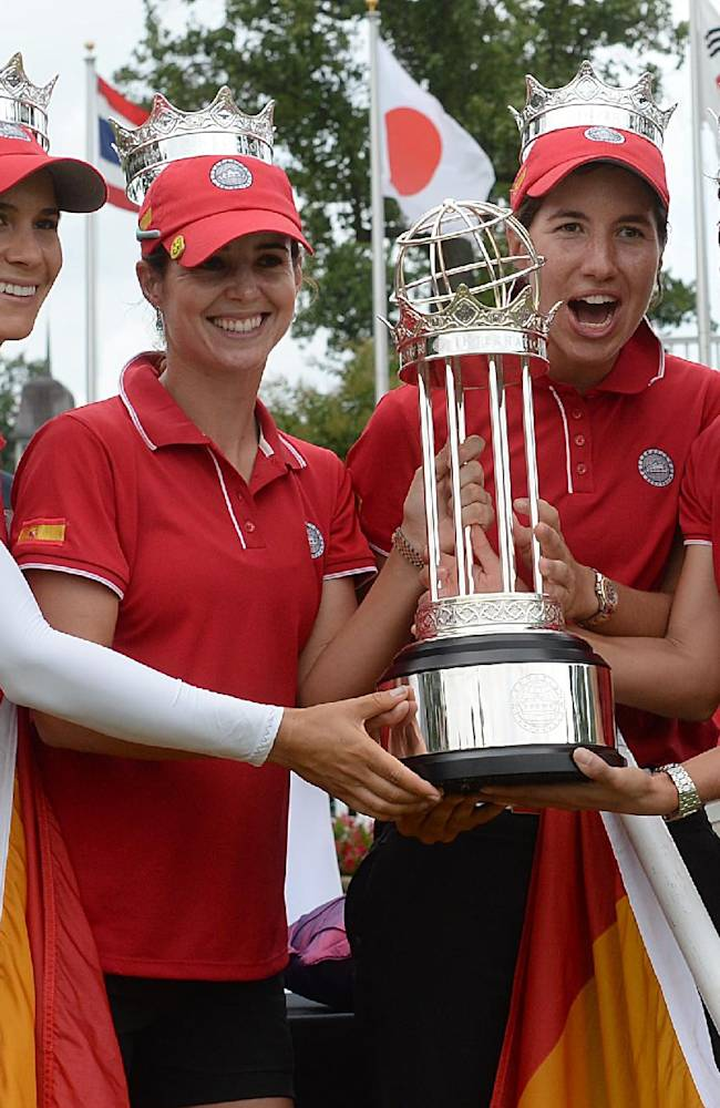 From left to right, Belen Mozo, Beatriz Recari, Carlota Ciganda and Azahara Munoz, all of Spain, hold the trophy after winning the International Crown golf tournament Sunday, July 27, 2014, in Owings Mills, Md